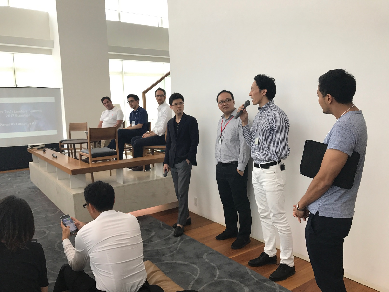 addlight's Tad Kimura (center) speaking at Japan Tech Leaders Summit